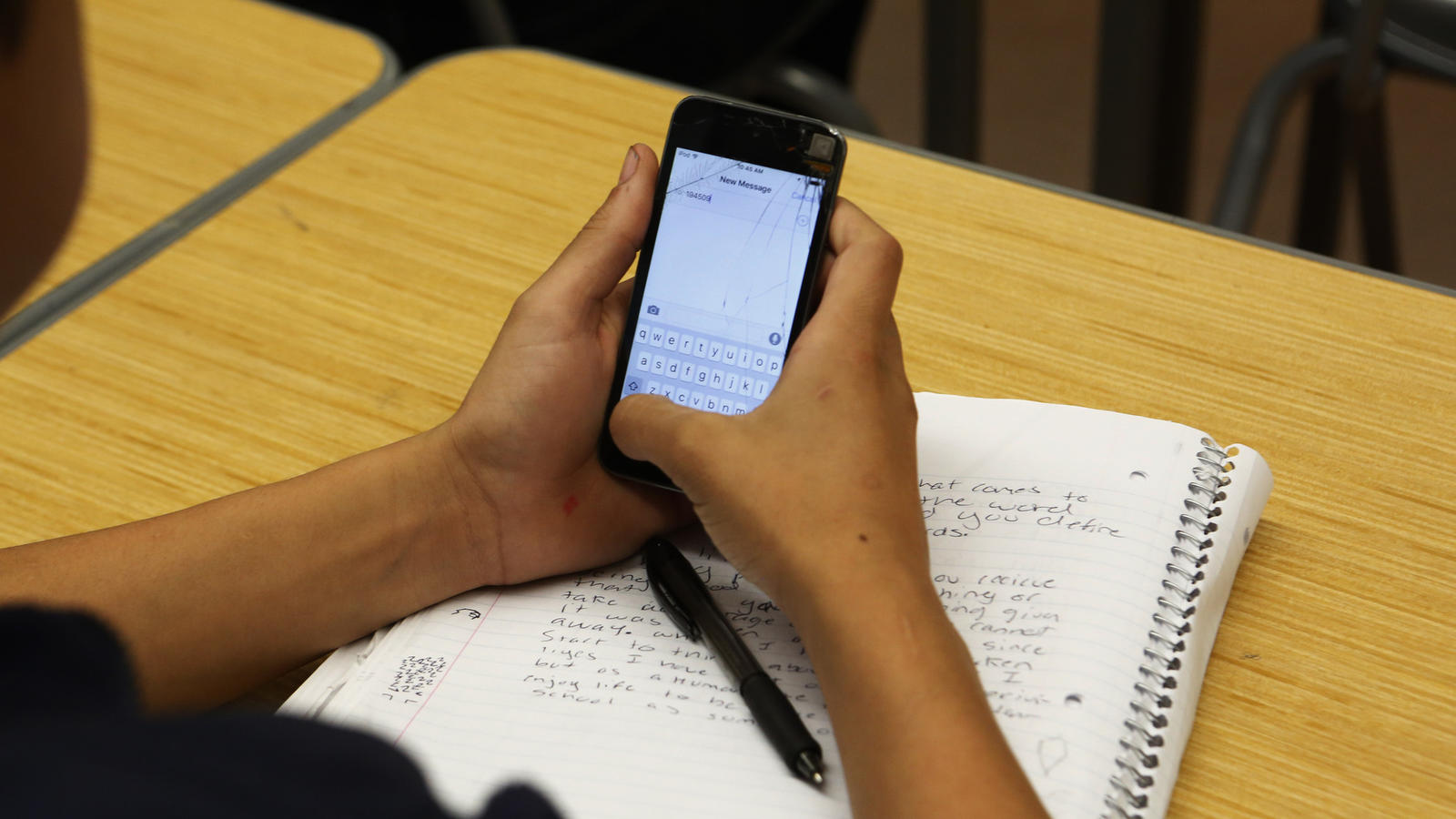 A student uses a cellphone in class to answer questions. (Anne Cusack / Los Angeles Times)