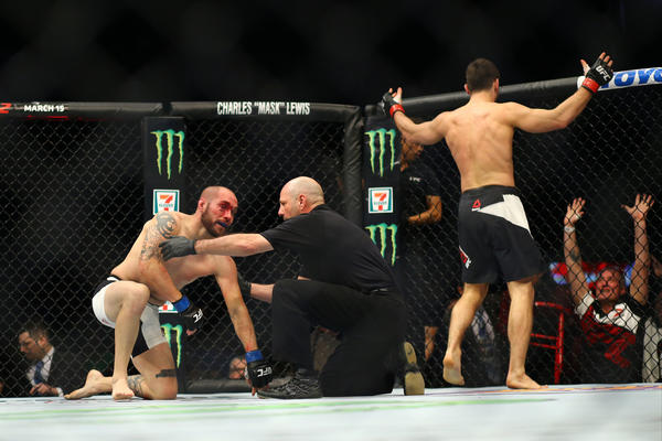 Jason Saggo celebrates after defeating Justin Salas. (Rey Del Rio / Getty Images)
