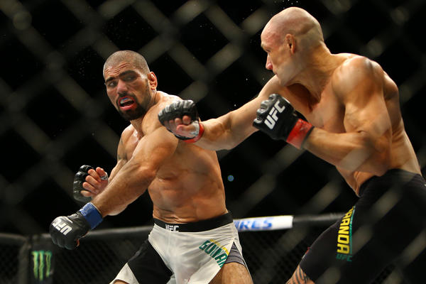 Marcelo Guimaraes, left, and Vitor Miranda trade blow. (Rey Del Rio / Getty Images)