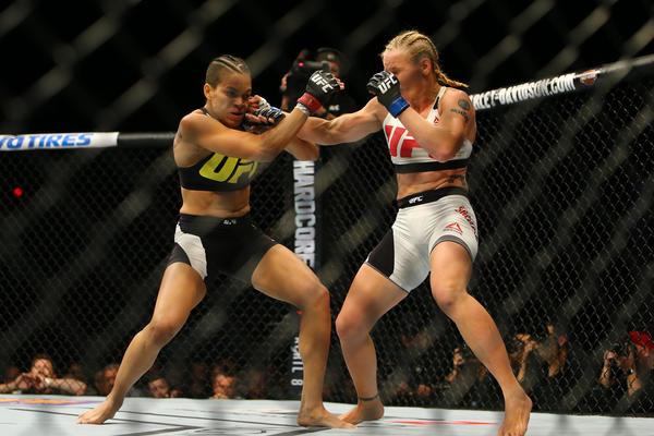 Valentina Shevchenko lands a punch against Amanda Nunes. (Rey Del Rio / Getty Images)