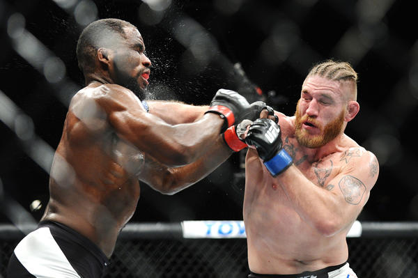 Corey Anderson and Tom Lawlor trade blows during UFC 196. (Wally Skalij / Los Angeles Times)