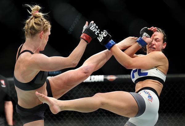 Holly Holm, left, and Miesha Tate trade kicks. (Wally Skalij / Los Angeles Times)