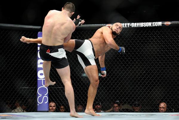 Gian Villante, left, tries to block a kick by Ilir Latifi. (Wally Skalij / Los Angeles Times)