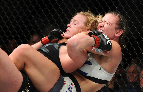 Miesha Tate applies the winning chokehold against Holly Holm. (Wally Skalij / Los Angeles Times)
