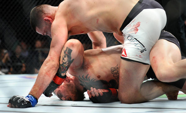 Nate Diaz takes down Conor McGregor. (Wally Skalij / Los Angeles Times)