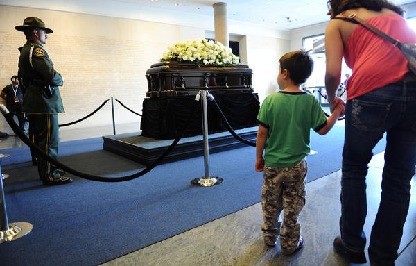 People come to pay their respects in front of the casket of former First Lady Nancy Reagan as she lies in repose at the Reagan Presidential Library in Simi Valley Wednesday. (Wally Skalij/Los Angeles Times)