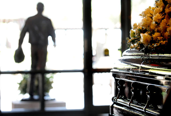 The casket of former First Lady Nancy Reagan lies in repose as a statue of her late husband, former President Ronald Reagan, stands outside the Reagan Presidential Library in Simi Valley. (Wally Skalij / Los Angeles Times)
