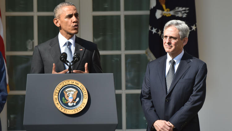 Supreme Court nominee Merrick Garland with President Obama in the White House Rose Garden on Wednesday. (Nicholas Kamm / AFP/Getty Images)
