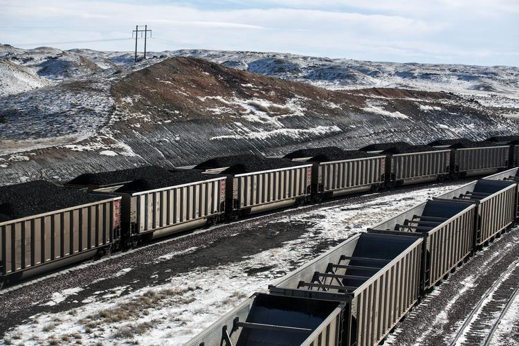 Rail cars filled with coal in Wyoming (Ryan Dorgan / Associated Press)