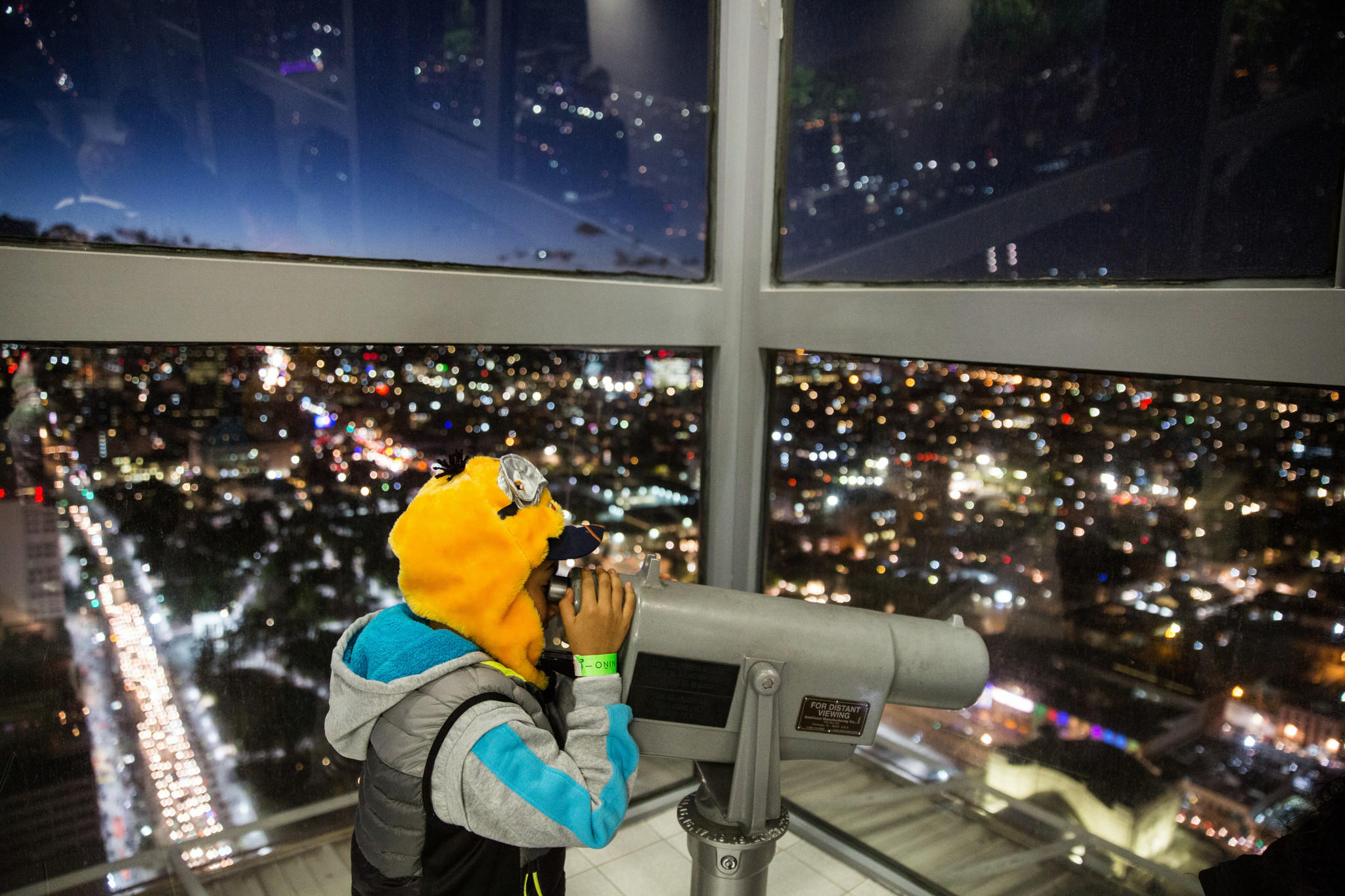 Alejandrao Ruiz, 9, looks into the telescope at the top floors of Torre Latinoamericana in Mexico City