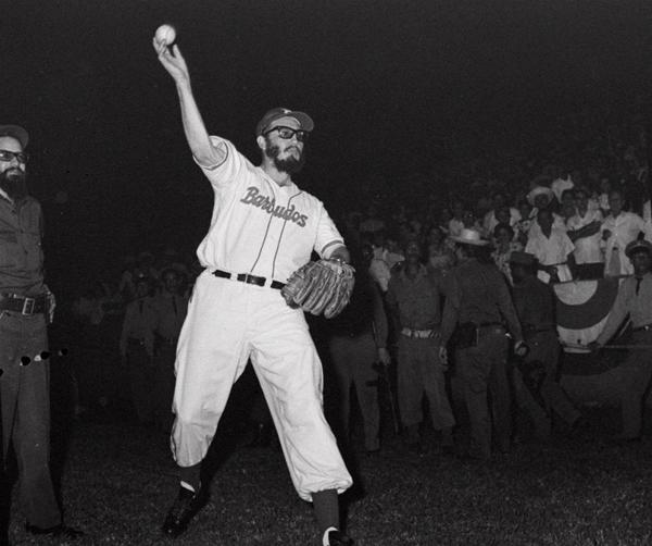 Fidel Castro throws a baseball before the start of a game between the Cuban military and the police on July 24, 1959.