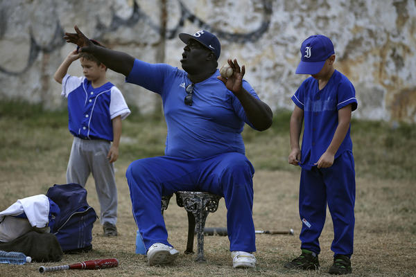 Lazaro Castillo, a retired baseball player who played for the 12-time Cuban League champion Industriales, coaches 7- and 8-year-olds in an instructional little league.