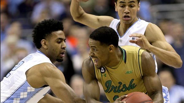 Notre Dame's Demetrius Jackson is trapped by North Carolina's Joel Berry II, left, and Marcus Paige, during a semifinal game of the ACC tournament on March 11. (Robert Willett / Raleigh News & Observer)