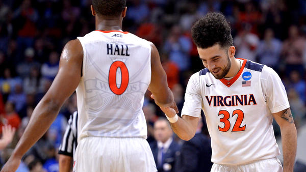 Virginia guard London Perrantes (32) and teammate Devon Hall celebrate during a win over Butler. (Grant Halverson / Getty Images)