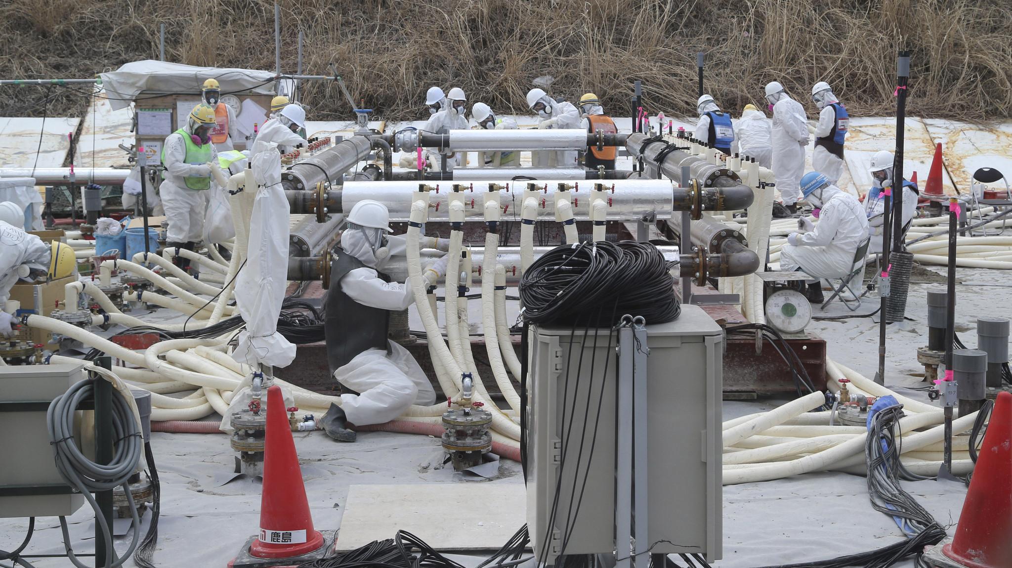 Japan regulators OK ice wall at Fukushima plant in bid to contain radioactive water