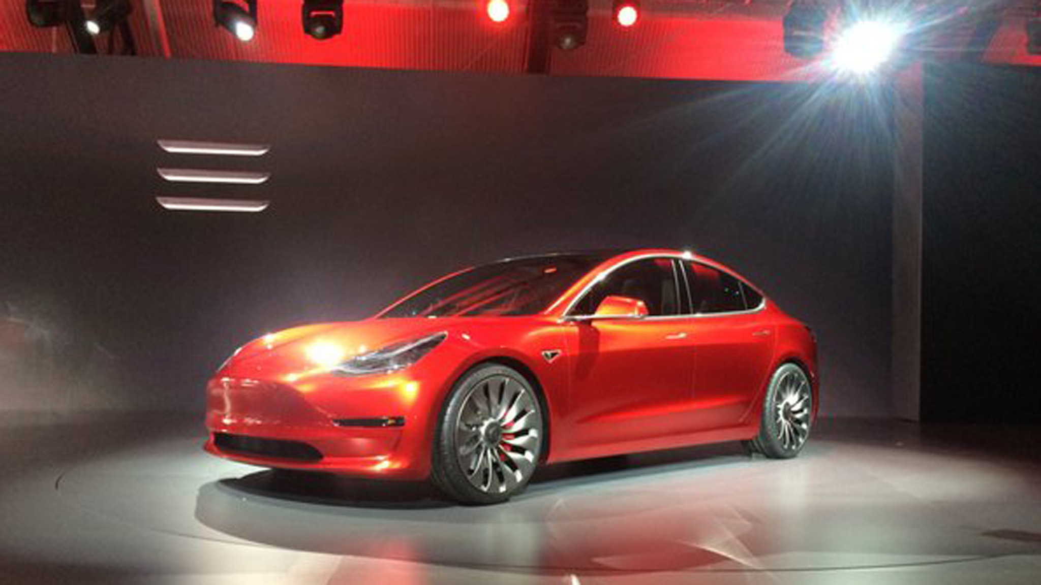 tesla model 3 elon musk unveils the model 3 to huge fanfare la times. Black Bedroom Furniture Sets. Home Design Ideas