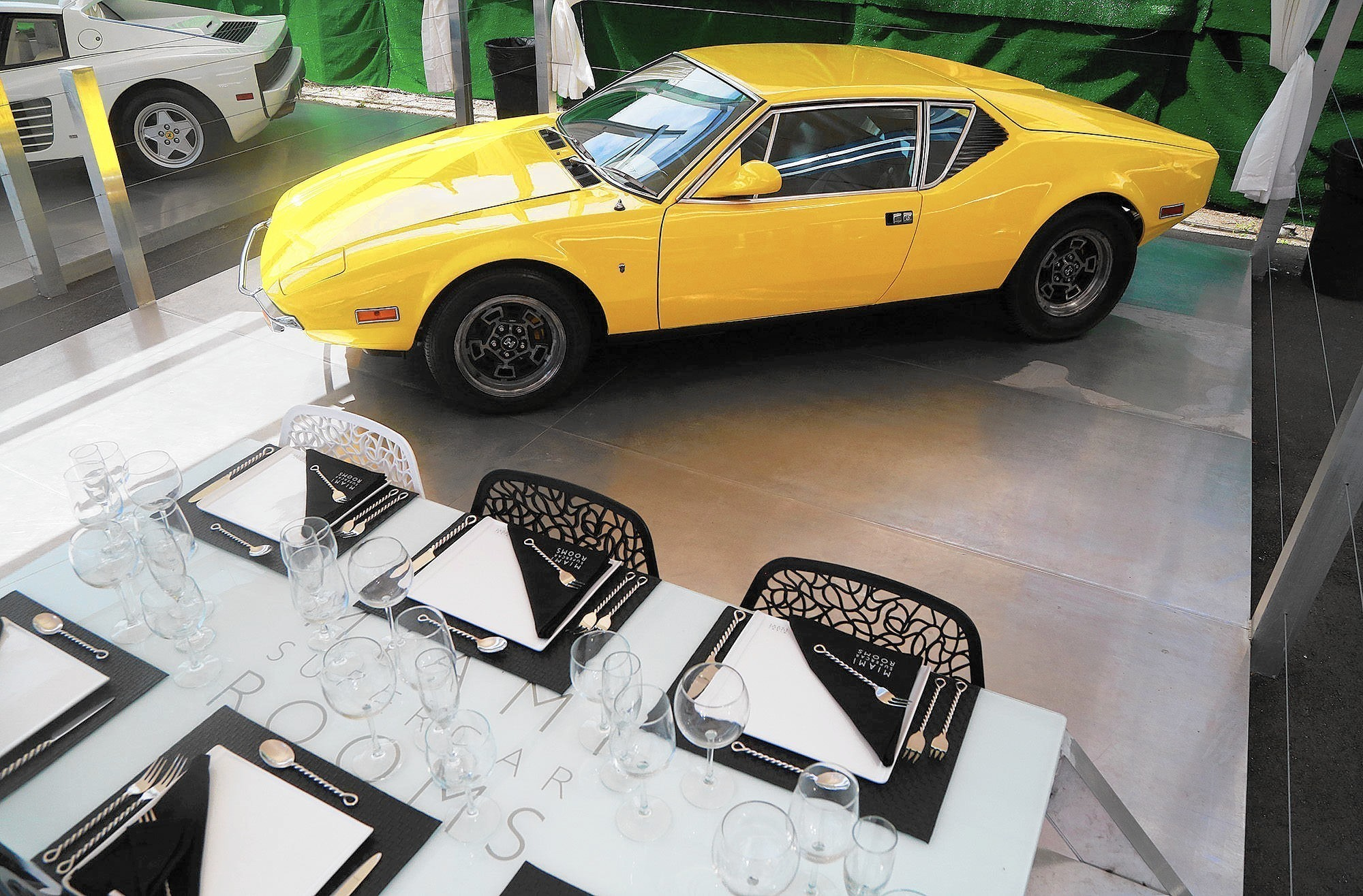Dinner & a DeLorean? Miami Supercar Rooms mixes exotic cars, gourmet ...