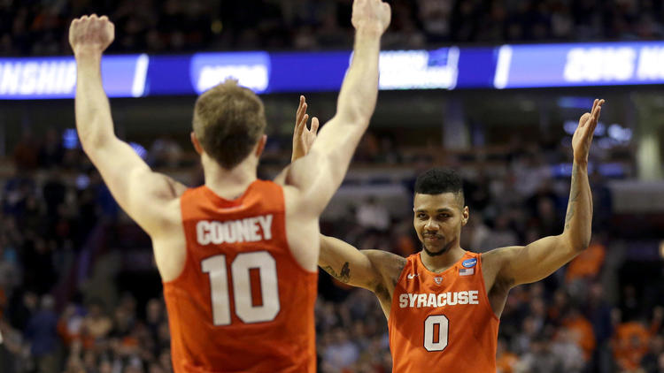 Syracuse seniors Trevor Cooney (10) and Michael Gbinije (0) are playing in their second Final Four, this time with the formidable task of playing North Carolina on Saturday. (Nam Y. Huh / Associated Press)