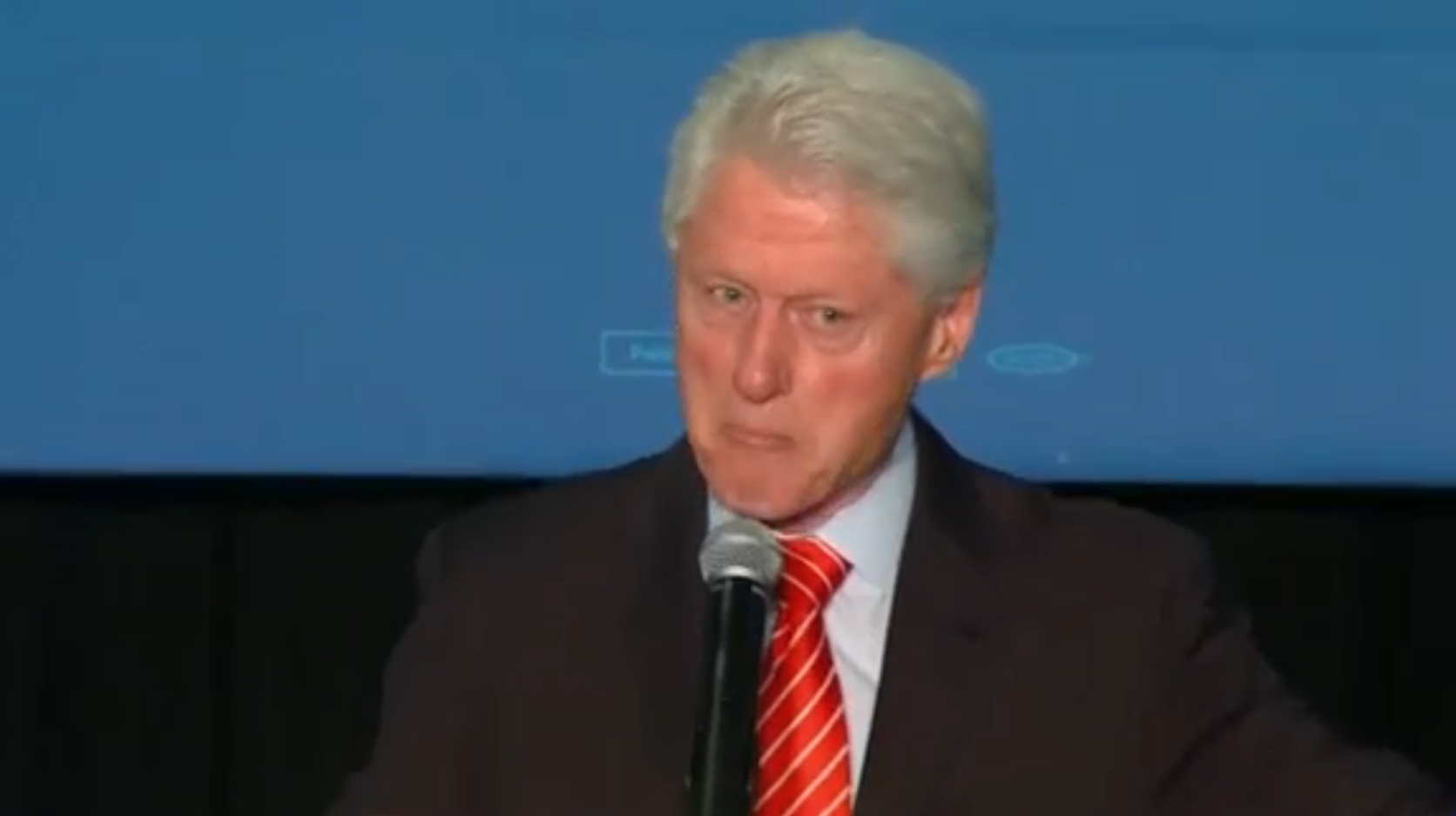 Bill Clinton has heated exchange with protesters at rally for Hillary