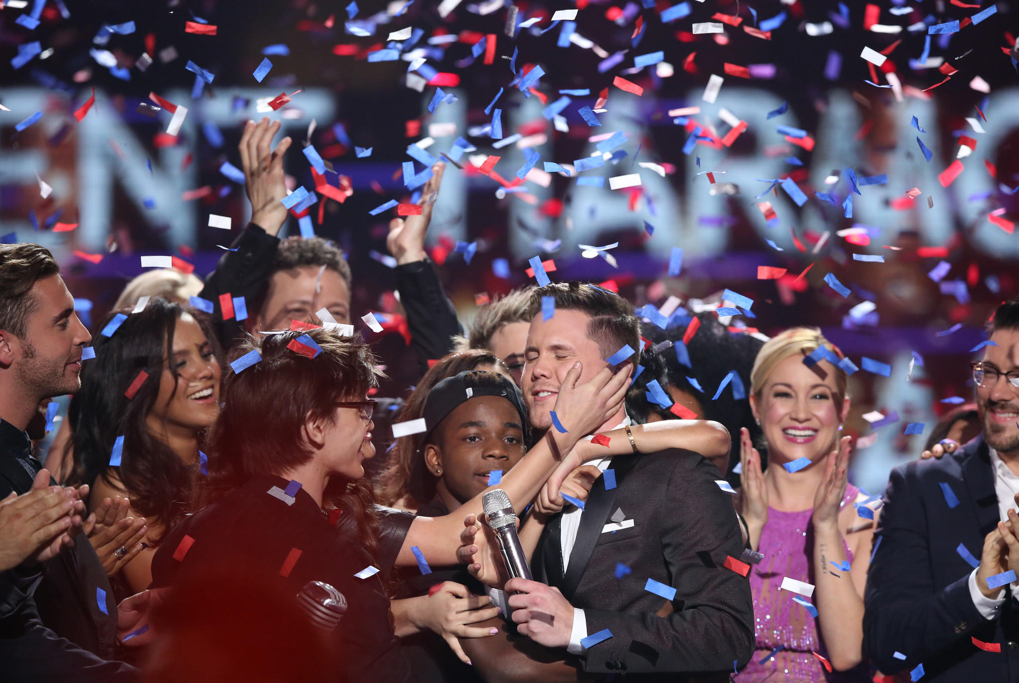 "Trent Harmon, a winner of ""American Idol,"" celebrates with fellow contestants. (Matt Sayles / Invision / Associated Press)"