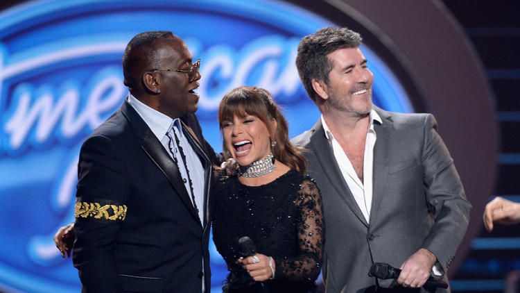 "The original Three Divas -- Randy Jackson, Paula Abdul and Simon Cowell -- reunite for the finale of ""American Idol."" (Kevork Djansezian / Getty Images)"