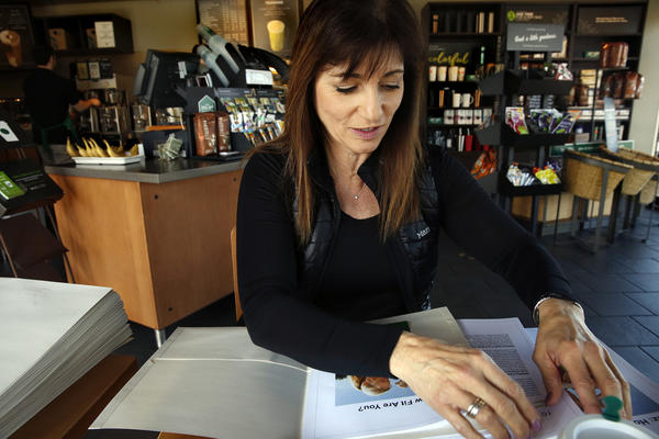 In between her appointments as a personal trainer, Trump supporter Peggy Hayes works at a Starbucks.