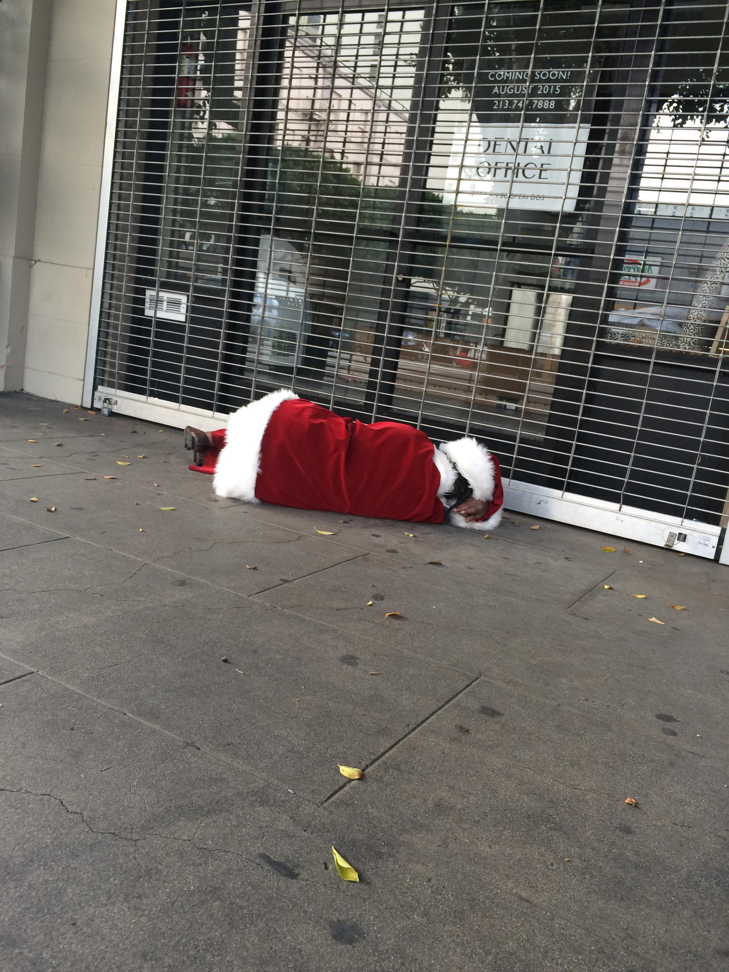 A man dressed as Santa Claus passed out in the middle of the day at 7th and Main.