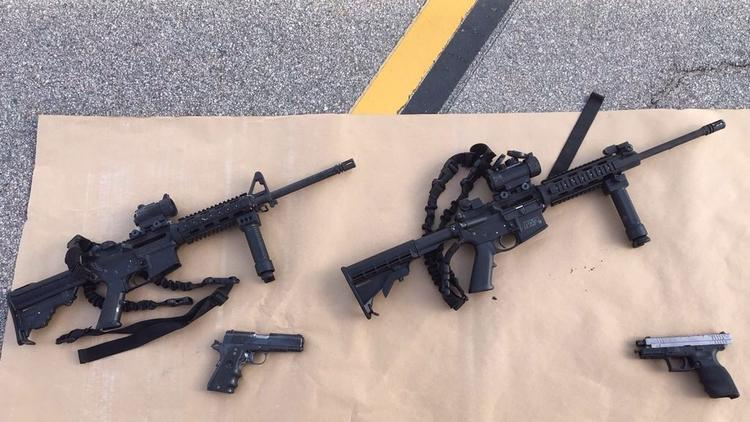 Four guns are seen near the site of a Dec. 4, 2015, shootout between police and suspects in San Bernardino. (San Bernardino County Sherrif's Department / Getty Images)