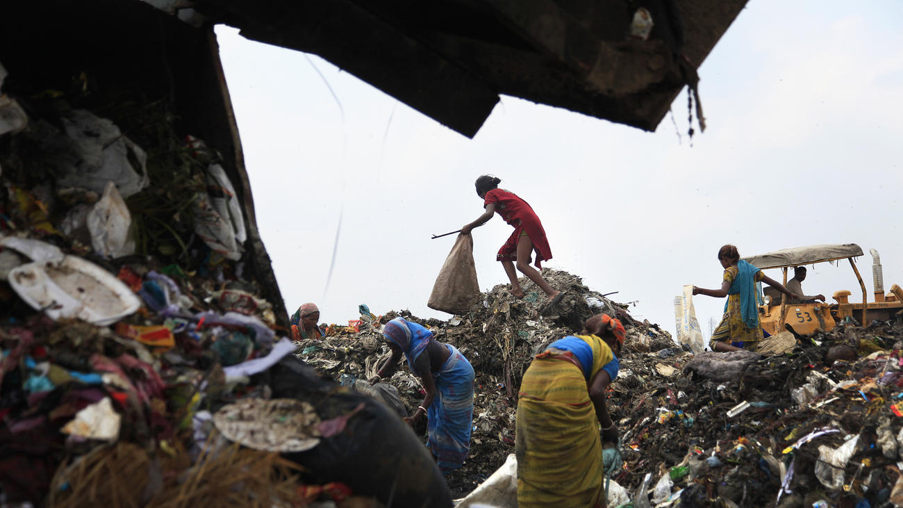 Rag pickers, as they are called, scavenge for food and recyclable materials at New Delhi's 70-acre, 100-foot-high Ghazipur landfill.