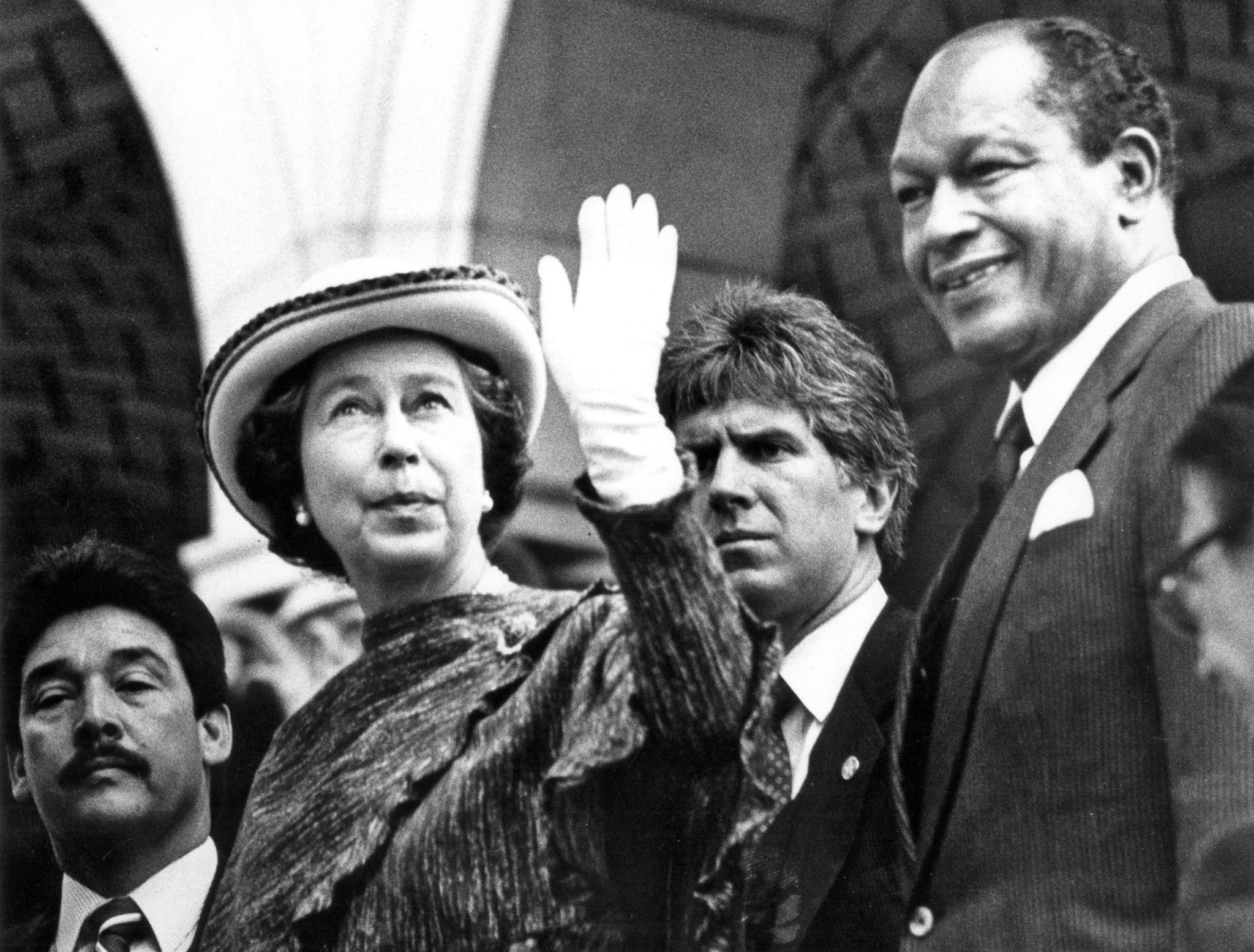 Feb. 28, 1983: Queen Elizabeth II waves to a crowd while being escorted into Los Angeles City Hall by Mayor Tom Bradley. This photo was published in the March 1, 1983, Los Angeles Times.