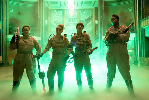 "Melissa McCarthy, left, Kate McKinnon, Kristen Wiig and Leslie Jones in a scene from ""Ghostbusters."""