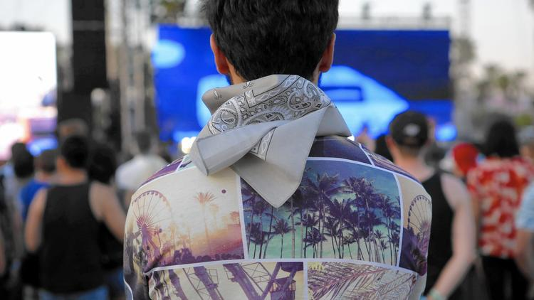 The not-so-usual Coachella first-timer: Abdullah Al-Rifaie, an 18-year-old Iraqi Muslim who loves Guns N' Roses, wearing his Coachella shirt. (Katie Falkenberg / Los Angeles Times)