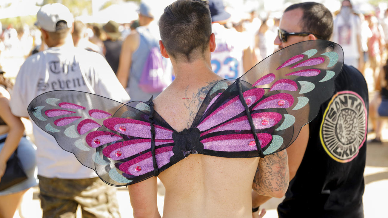 A man wearing wings walks through the crowd Friday, the opening day of Weekend 2 at the Coachella Valley Music and Arts Festival in Indio. (Jay L. Clendenin / Los Angeles Times)