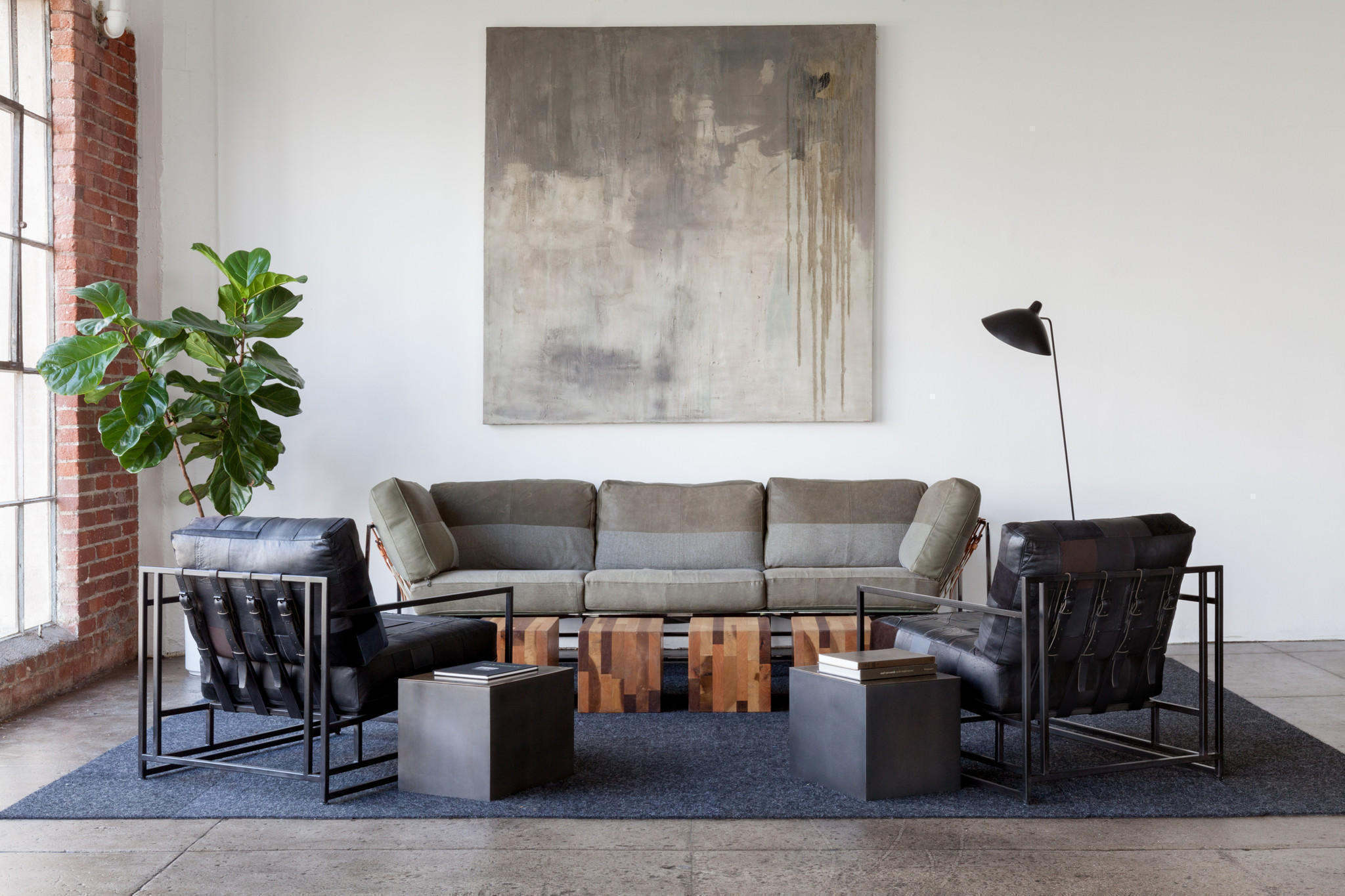 Kenn and the menswear label longjourney includes armchairs made from repurposed leather motorcycle jackets and a sofa upcycled from vintage sweatshirts
