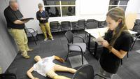 Academy participants delve into fake crime scene