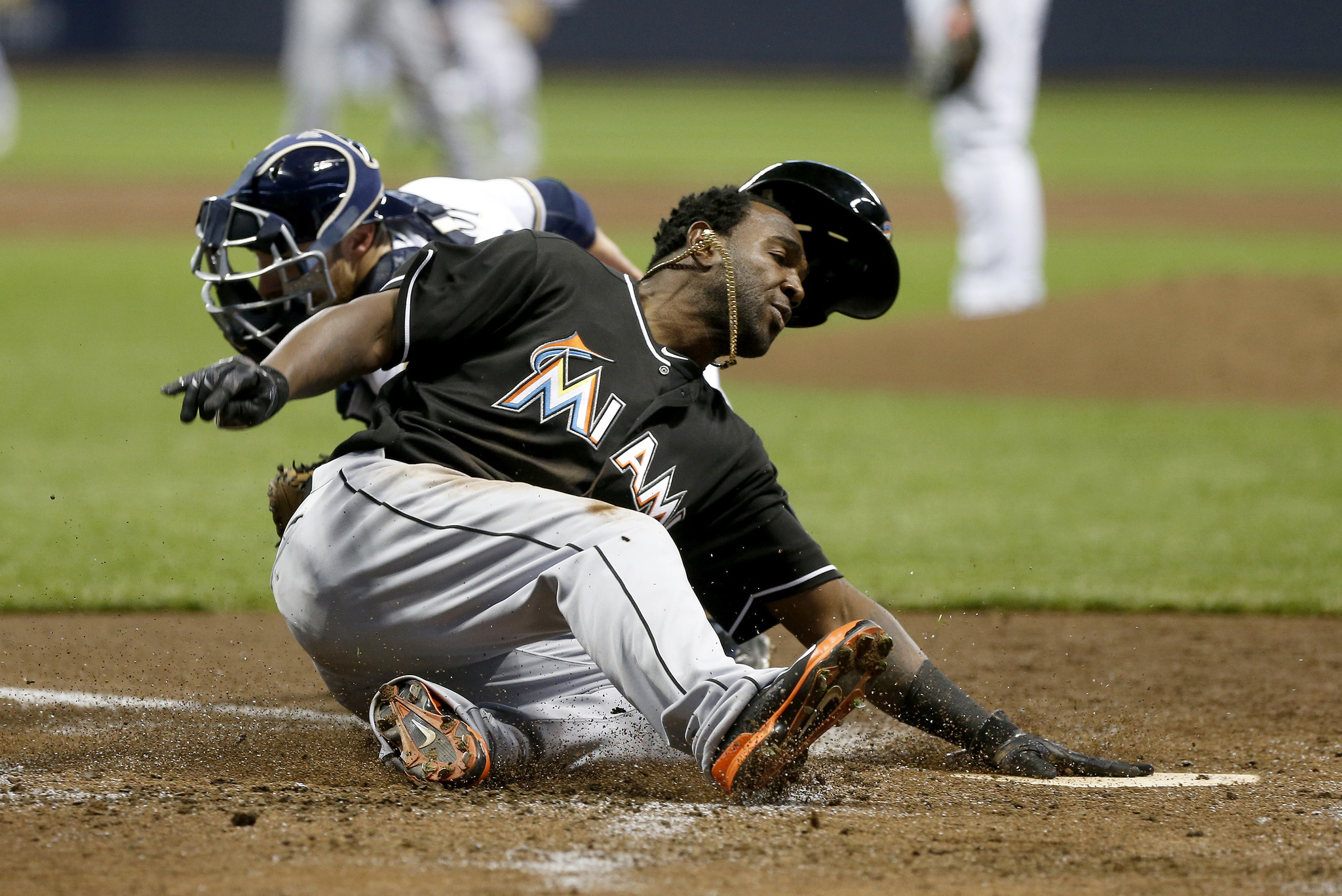 Sfl-marlins-hit-4-hrs-survive-17-lob-to-top-brewers-win-7th-in-a-row-20160430