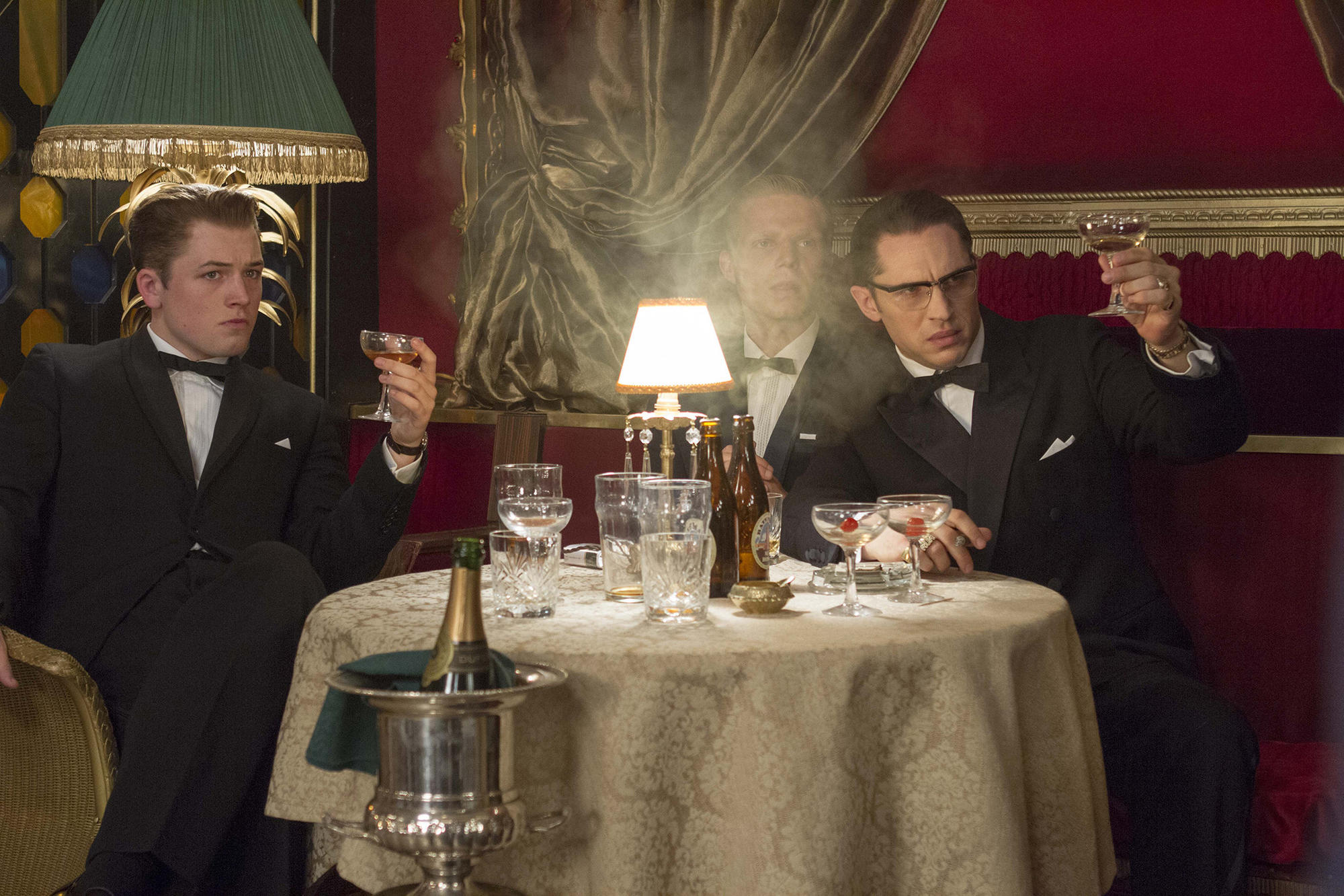 "Taron Egerton, Charley Palmer Rothwell and Tom Hardy in ""Legend."""