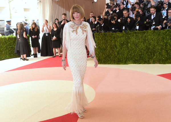 Vogue editor in chief Anna Wintour goes with a cream-colored fringe frock at the Met Gala. (Charles Sykes / Invision / AP)