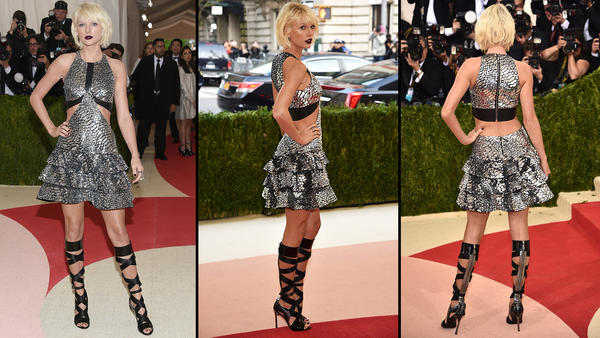 Taylor Swift arrives at the Met Gala with a rock edge in a short frock. (Evan Agostini / Invision / AP; Dimitrios Kambouris / Getty Images)