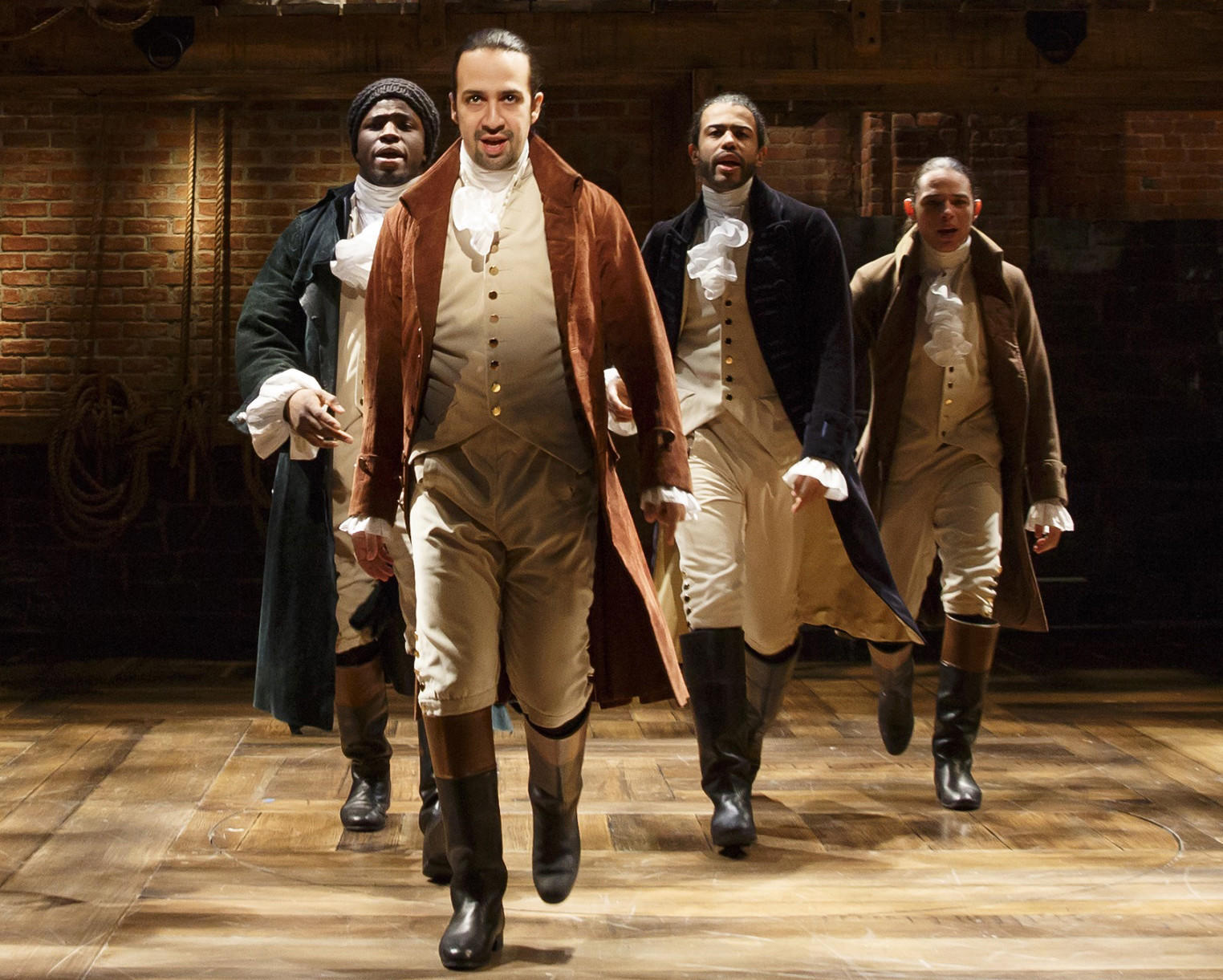 "Lin-Manuel Miranda, creator and star of ""Hamilton,"" forges ahead, backed by, from left, Okieriete Onaodowan, Daveed Diggs and Anthony Ramos. (Joan Marcus)"