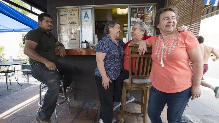 Soccoro Herrera, center, with daughters Dora, left, and Margarita, right, a