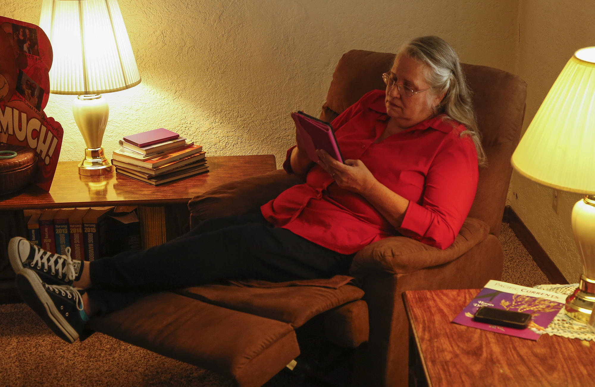When she isn't being the caregiver for her mother, Long Beach resident Cheri Brown spends her spare time using the coloring app, Recolor on her iPad Mini.