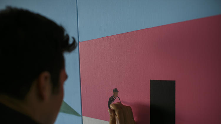 """Ramiro Gomez works on """"Melrose Avenue, Eastbound,"""" a suite of 11 paintings"""