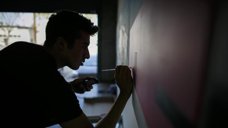 Gomez at work in his studio.