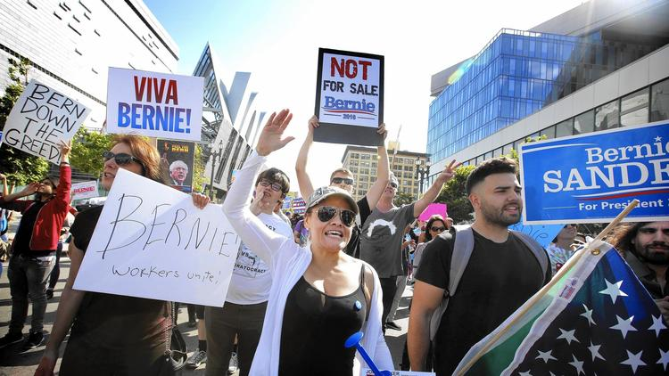 Sanders supporters march in downtown L.A. The campaign is already relying more on activism in California and less on media buys. (Barbara Davidson / Los Angeles Times)
