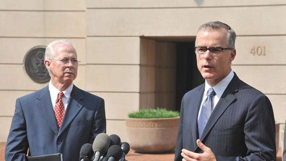 Andrew McCabe, right, in 2015. With him is Dana J. Boente, the U.S. attorney for the Eastern District of Virginia. (FBI)