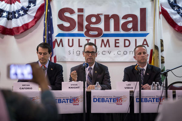 Candidates for the 25th Congressional District seat — attorney Bryan Caforio, left, incumbent Steve Knight and LAPD Lt. Lou Vince — debate in Newhall on May 5. (Gina Ferazzi / Los Angeles Times) None