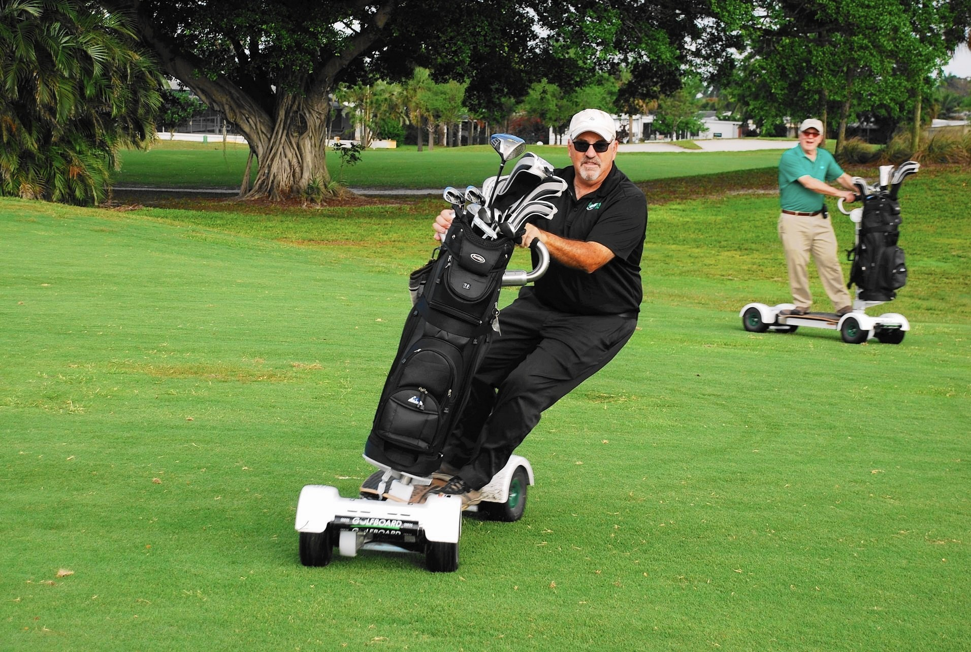 Waters: GolfBoard appeals to players of all ages - Sun Sentinel on michael jordan golf cart, adam sandler golf cart, tiger woods golf cart, peyton manning golf cart, surfing golf cart, jeff gordon golf cart,