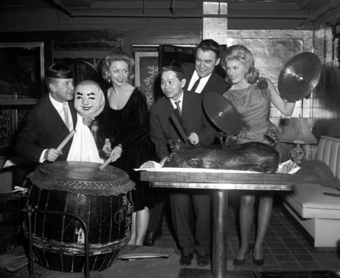 Singers Danny O'Nell, from left, and Jan Norris, restaurant owner Jimmy Wong, orchestra leader Franz Benteler and actress June Wilkinson celebrate the Chinese New Year at Wong's restaurant in1964.