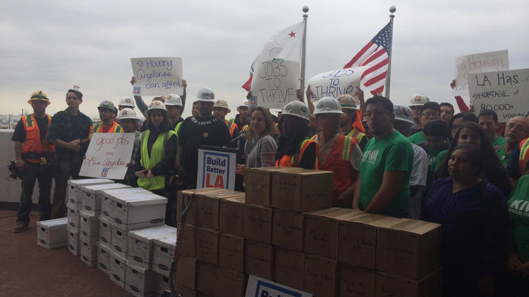 Labor and housing activists deliver boxes of signed petitions for their proposed Build Better L.A. ballot measure to the Los Angeles City Clerk.